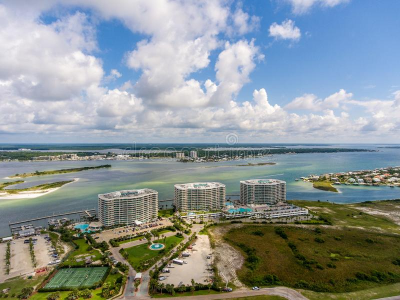 Orange Beach, Alabama on the Gulf Coast. Seascape, shores, aerial, view, sand, summer, baldwin, waves, travel, vacation, blue, sky, clouds, resort stock photo