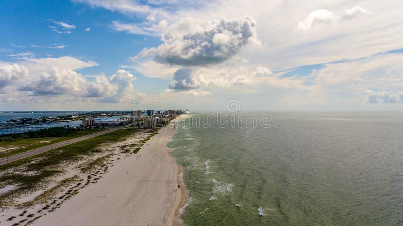 Orange Beach, Alabama on the Gulf Coast. Seascape, shores, aerial, view, sand, summer, baldwin, waves, travel, vacation, blue, sky, clouds, resort stock images
