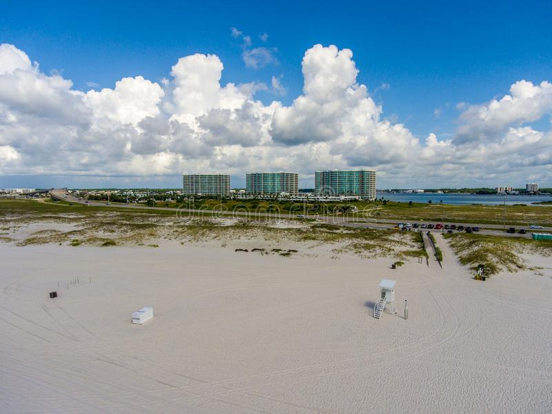 Orange Beach, Alabama on the Gulf Coast. Seascape, shores, aerial, view, sand, summer, baldwin, waves, travel, vacation, blue, sky, clouds, resort stock image