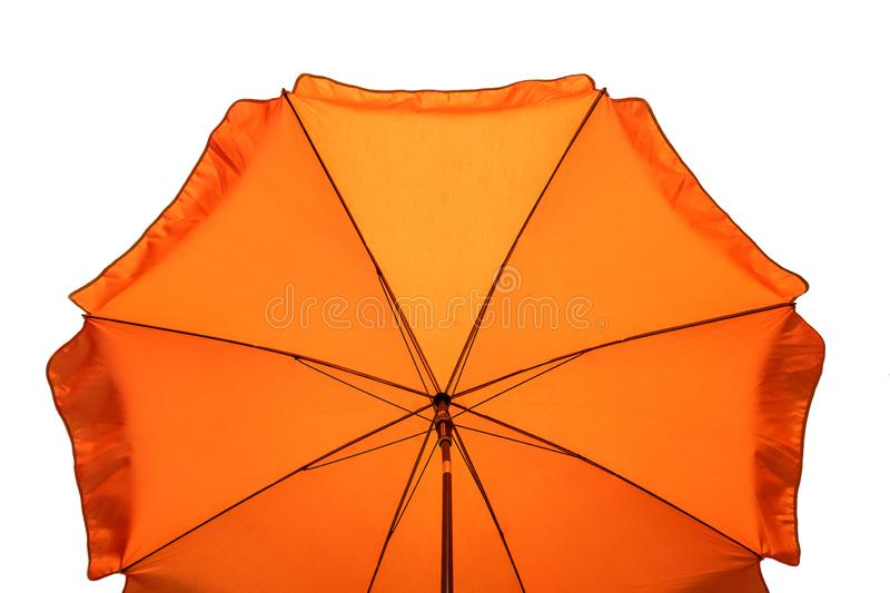 Orange beach umbrella isolated on white. Clipping path included stock photography