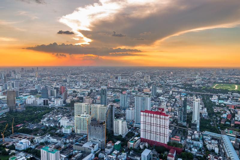 orange beautiful sunset over the big metropolis capital of Thailand, view of Bangkok from the skyscraper stock photography