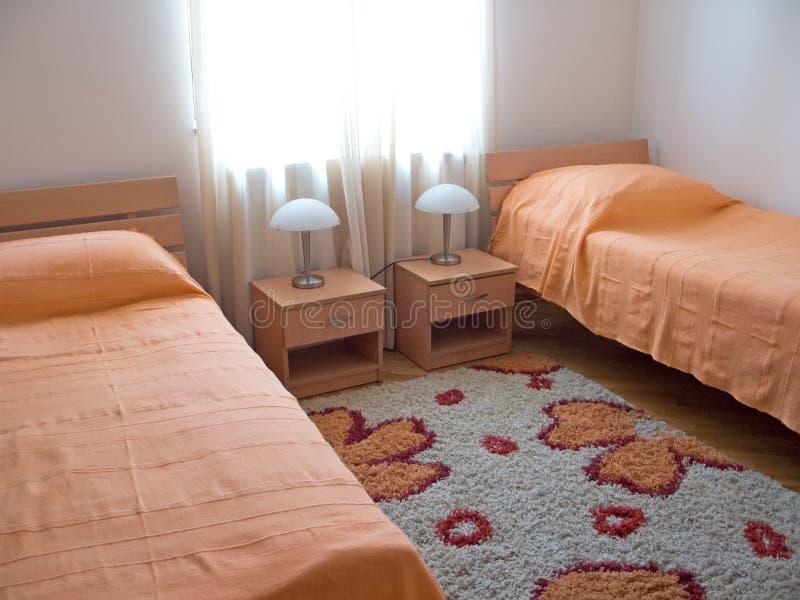 Orange bedroom stock photography