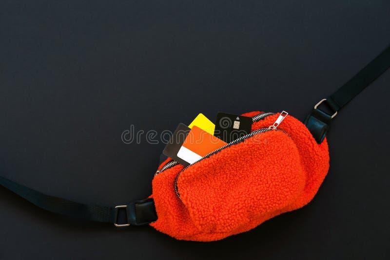 Orange belt bag with credit card. Black Friday sale concept.  royalty free stock image