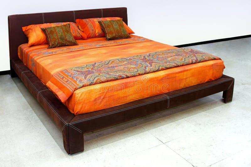 Orange Bett lizenzfreies stockfoto