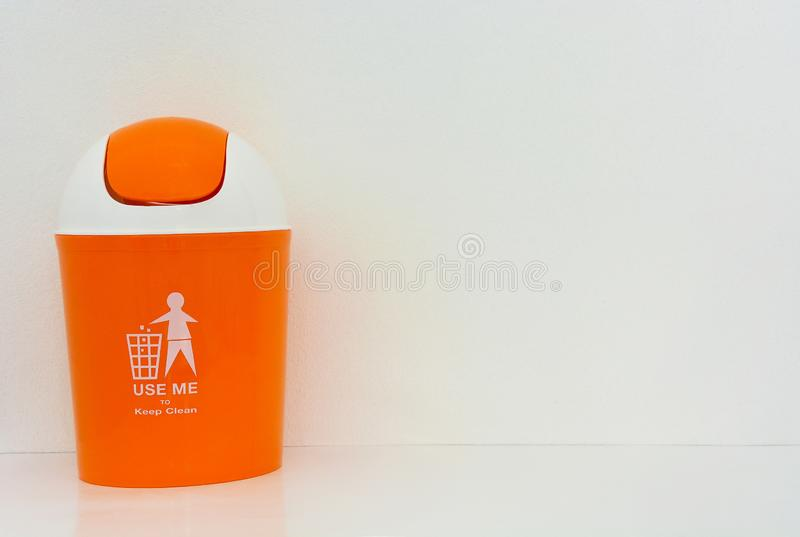 Orange bin with text on white background. Copy space box cartoon clean cleanup concept conservation container digitally disposal eco ecology empty environment stock photo