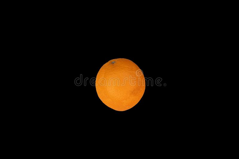 Orange on the black background royalty free stock images