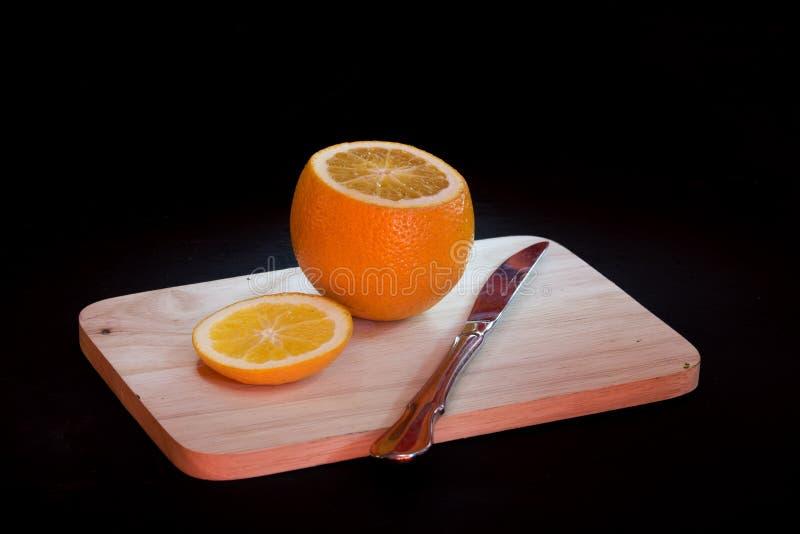 Orange on black background royalty free stock photography