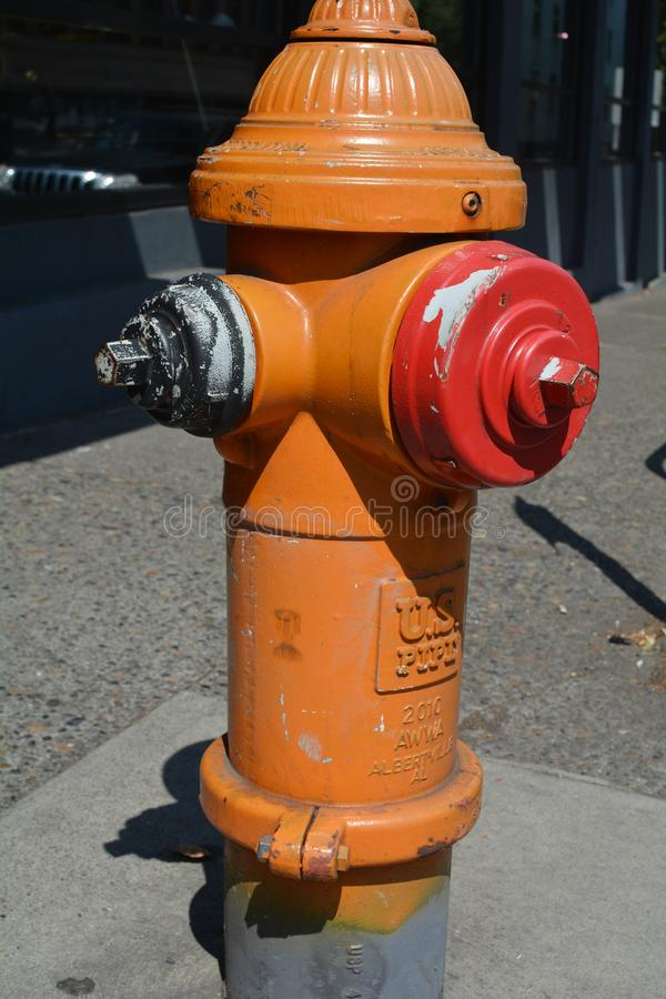 Fire hydrant in Portland, Oregon. This is an orange, black, and red fire hydrant on a downtown Portland, Oregon street royalty free stock photography