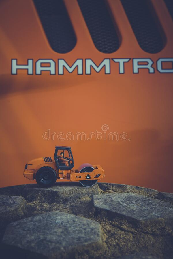 Orange and Black Road Roller Toy on Black Stone royalty free stock image