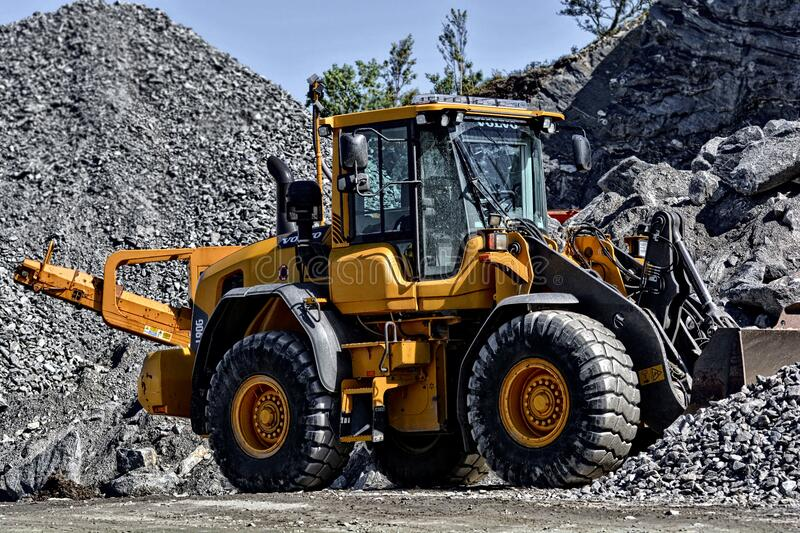 Orange And Black Tractor Next To Piles Of Rocks Free Public Domain Cc0 Image