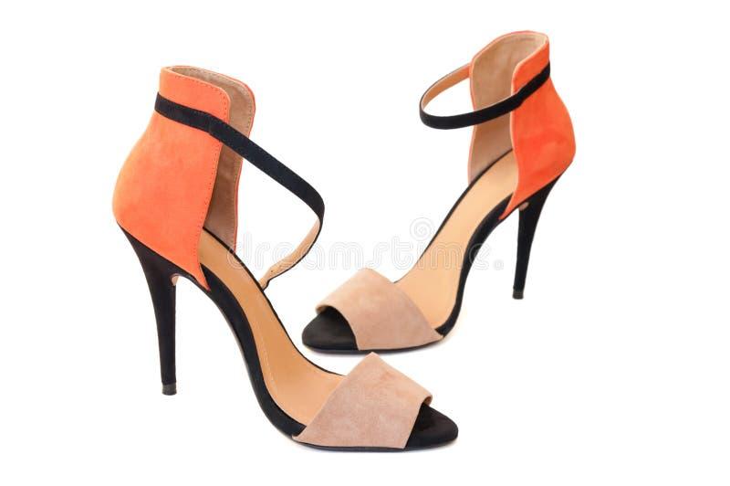 Orange and black woman high heels shoes