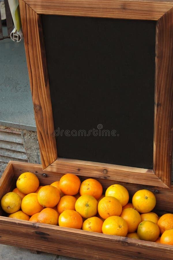 Orange and blackboard royalty free stock photo