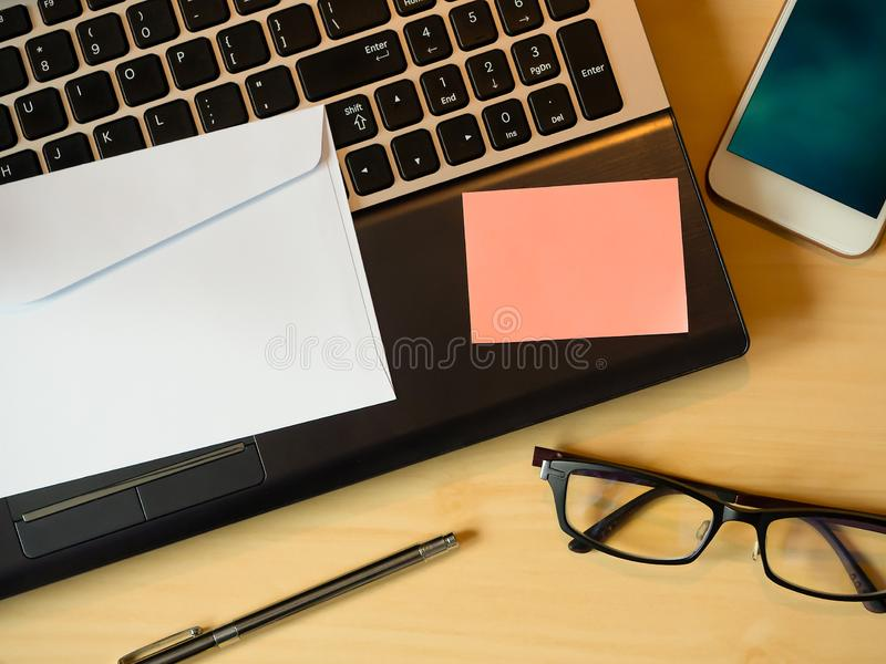 Orange blank note or message in the letter  on the table stock images