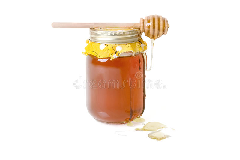 Orange Blossom Honey. With a wood drizzler on top, dripping with honey - on white stock photography