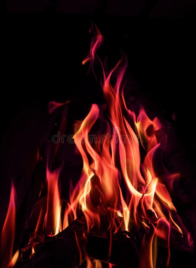 Orange and blue fire flames on black background royalty free stock photo