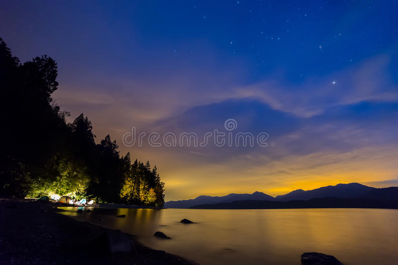 Orange and Blue Night Sky With Tents Camping stock photos