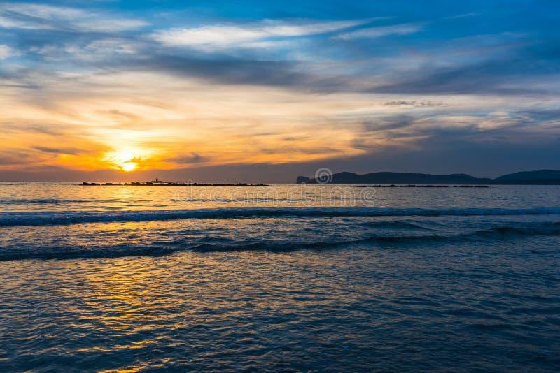 Orange and blue sky ove the sea at sunset. Sardinia, Italy royalty free stock photo
