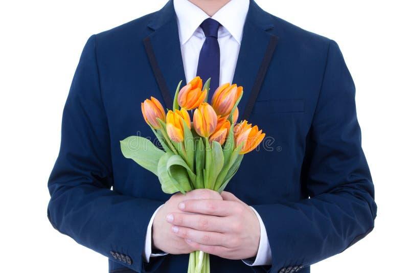 Orange Blumen in den männlichen Händen lokalisiert auf Weiß lizenzfreie stockfotos