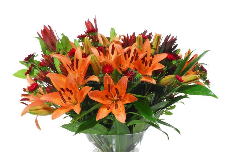 Orange Blumen der schönen Lilie mit grünem Blatt lizenzfreies stockbild