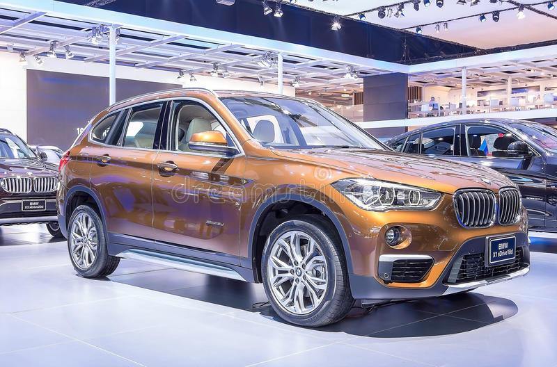 Orange BMW series X1 sDrive 18d. Bangkok - March 22 : orange BMW series X1 sDrive 18d - in display at The 37th Bangkok international Motor Show 2016 on March 22 royalty free stock images