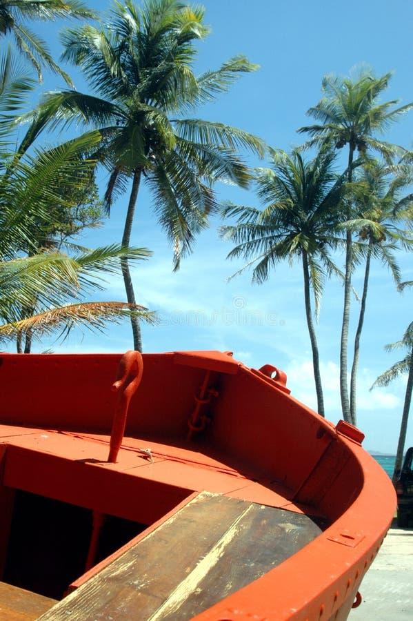 orange boat on beach Bequia