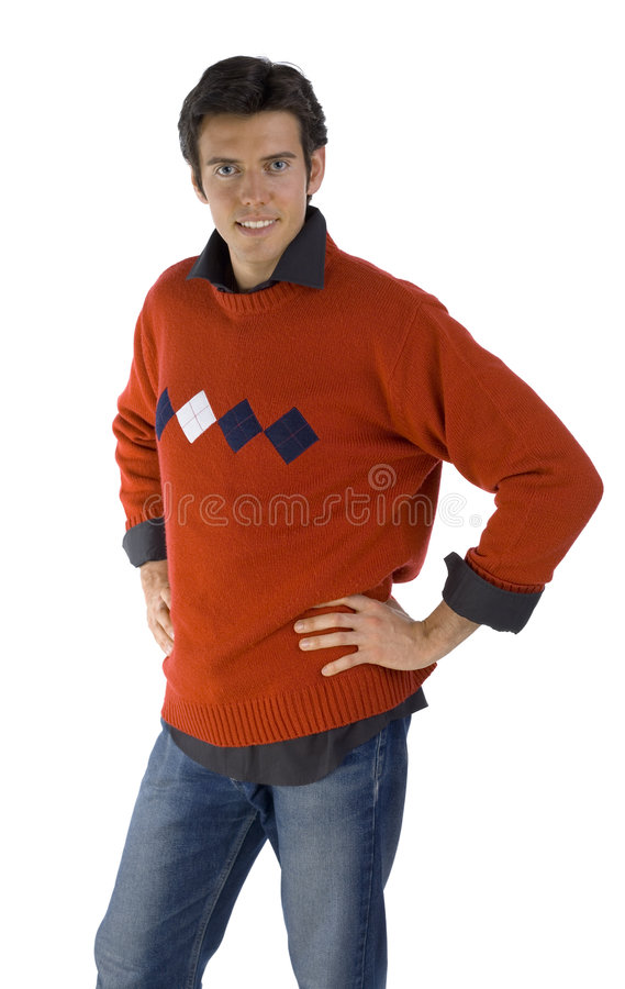 Orange boy. Smiling, handsome man wearing orange jersey, black shirt and denim jeans. Looking at camera. Isolated on white in studio stock photos
