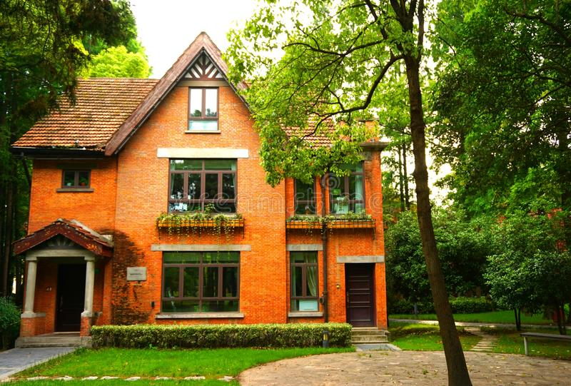 An Orange brick European style house. In the image, there is an orange brick European style house stock image