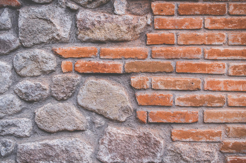 Orange brick and stones in wall royalty free stock images