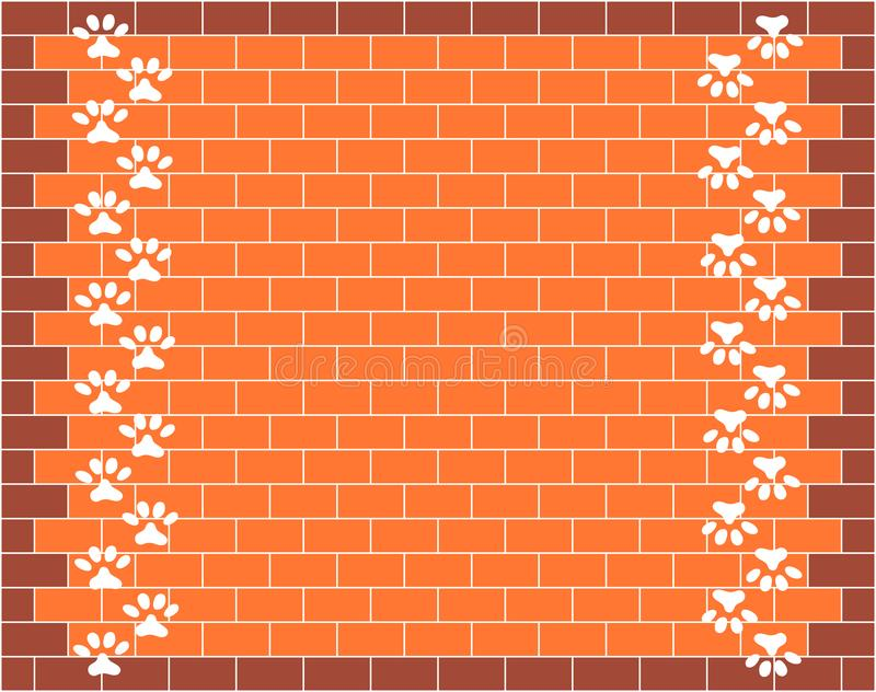 Orange brick wall graphic design with animal paw prints royalty free stock photo