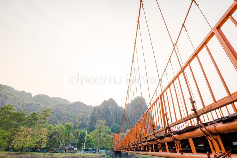 Orange bridge over song river in Vang Vieng,Laos stock photo