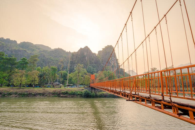 Orange bridge over song river in Vang Vieng,Laos stock image