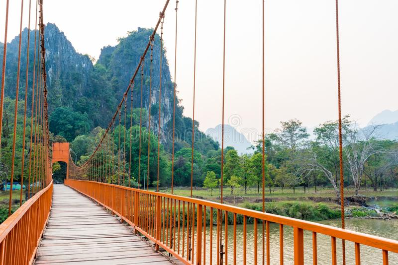 Orange bridge over song river in Vang Vieng,Laos royalty free stock images