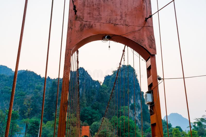 Orange bridge over song river in Vang Vieng,Laos royalty free stock image
