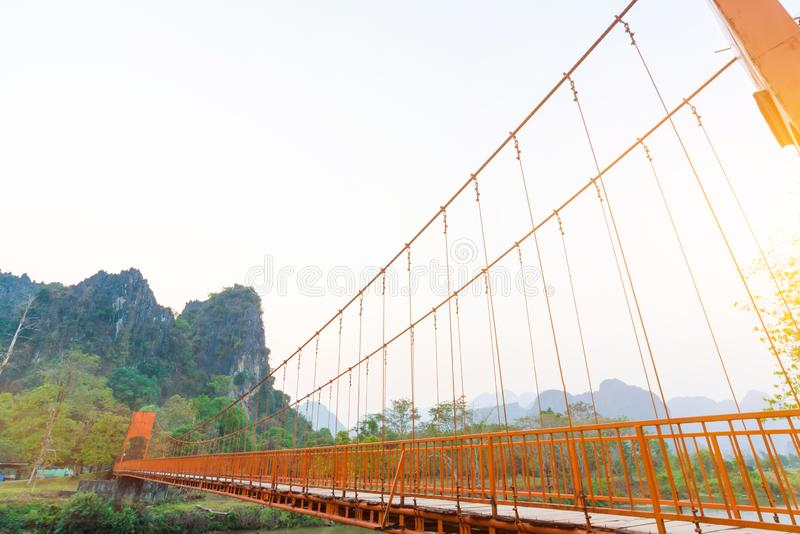 Orange bridge over song river in Vang Vieng,Laos royalty free stock photography