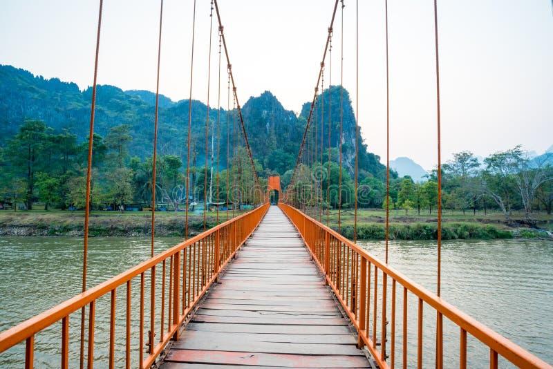 Orange bridge over song river in Vang Vieng, Laos royalty free stock images