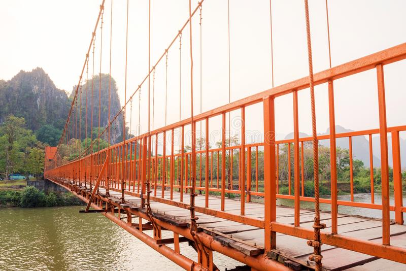 Orange bridge over song river in Vang Vieng,Laos stock photos