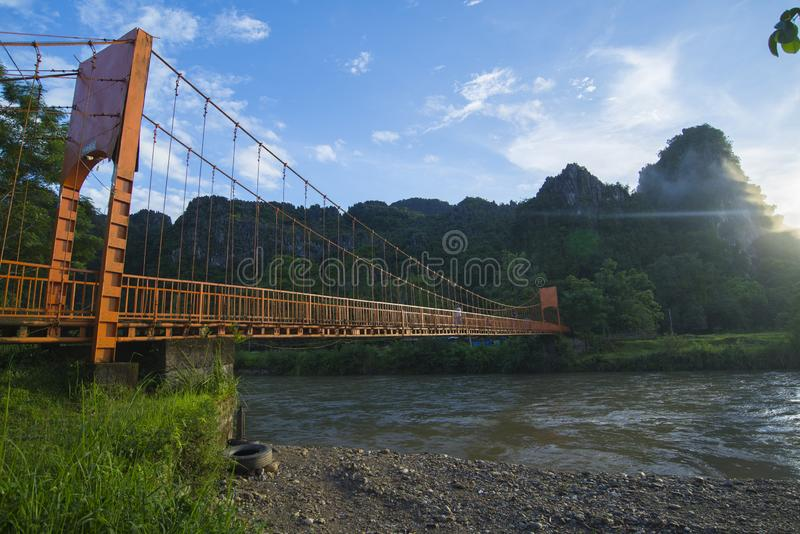 ORANGE BRIDGE, VANG VIENG, LAOS - JULY 25, 2019: stock photography