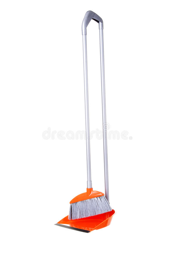Orange broom and scoop. Isolated on white royalty free stock images