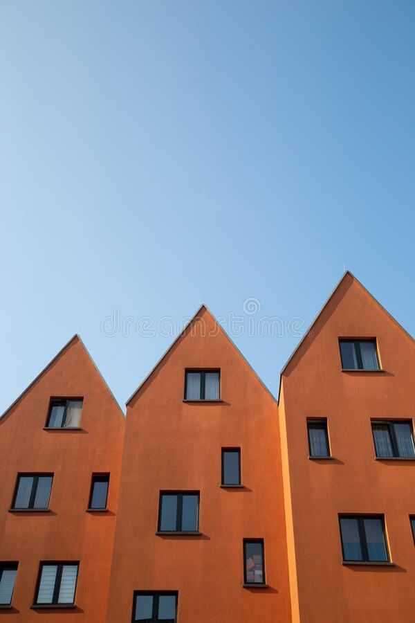 Orange brown apartment residential building under blue sky in Frankfurt, Germany. Europe stock photography