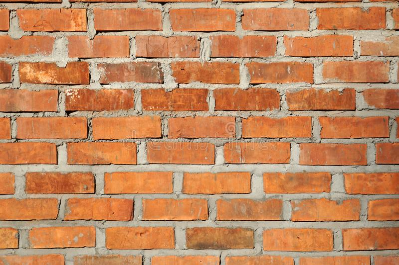 Orange brown brick wall background texture. House royalty free stock photo