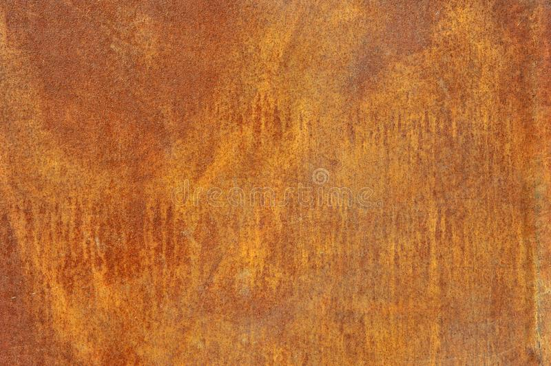 Orange brown corroded metal or steel shee. Orange brown old rusted corroded metal or steel sheet horizontal wall background as abstract dirty textured metallic royalty free stock photography