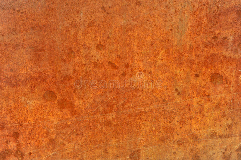 Orange brown old rusted corroded metal or steel. Sheet horizontal wall background as abstract dirty textured metallic vintage industries royalty free stock images