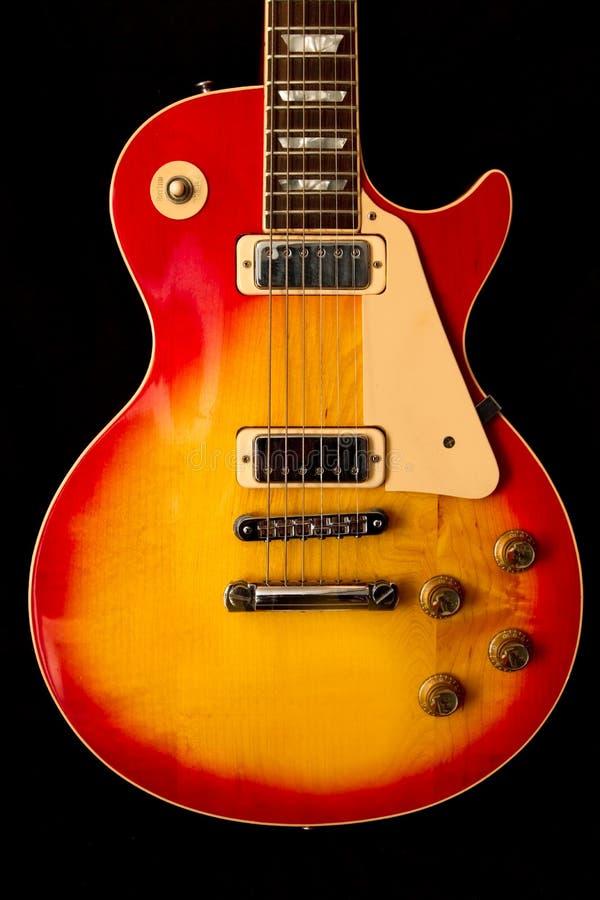 Orange Burst Guitar stock photo