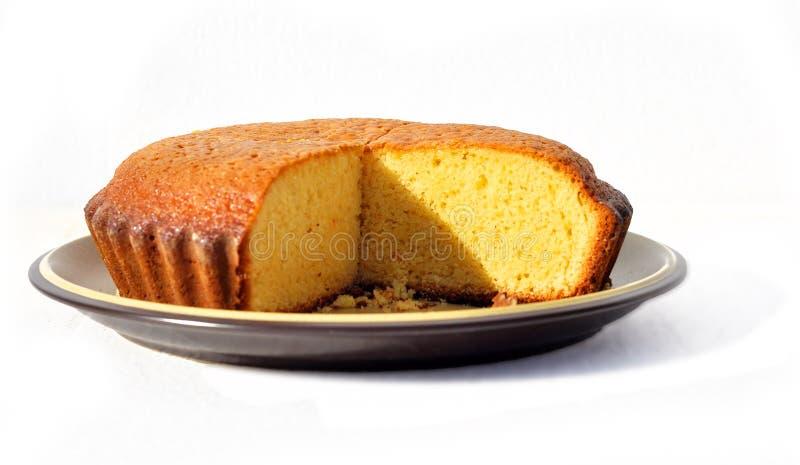 Orange cake. Three quarters of a home made orange cake stock photos