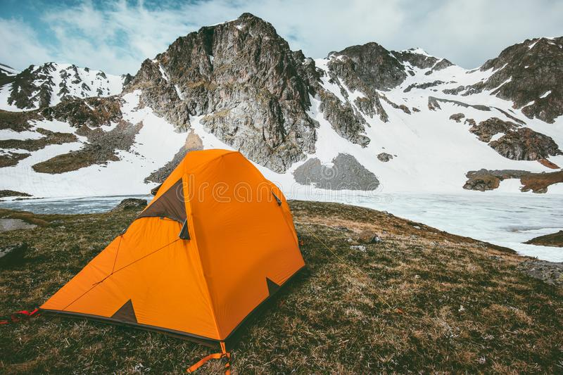 Orange camping tent in Mountains Landscape Travel Lifestyle. Concept adventure vacations outdoor hiking gear equipment stock photography