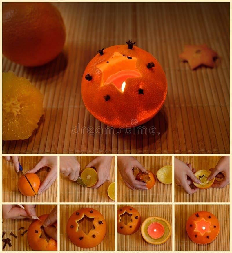 Orange candle orange crafts instruction homemade cloves christmas advent. Christmas orange candle do it yourself manual stock photography