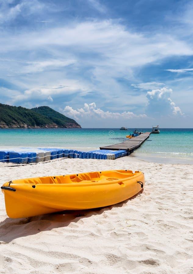 Orange canoe kayak lying on a beach stock photos