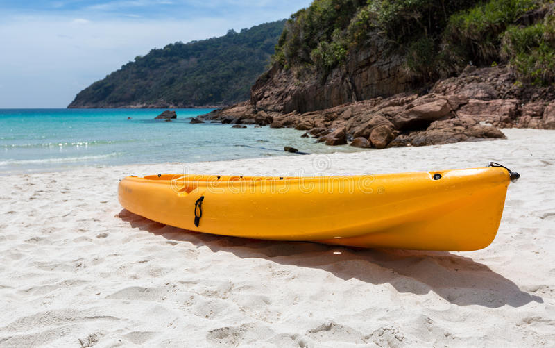 Orange canoe kayak lying on a beach stock photo