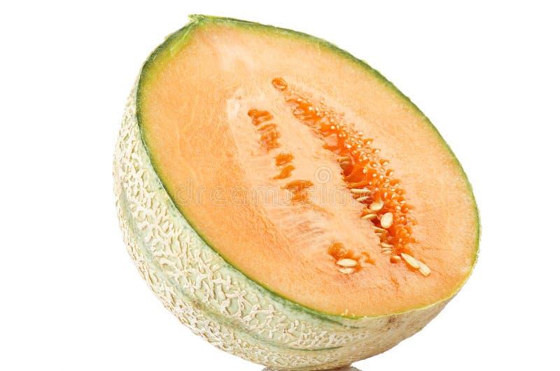 Orange cantaloupe melon. Sliced close up on the white royalty free stock photo