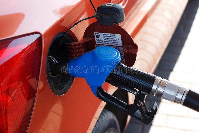 Orange car at gas station royalty free stock photo